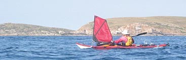 Michael paddling and sailing in calm conditions