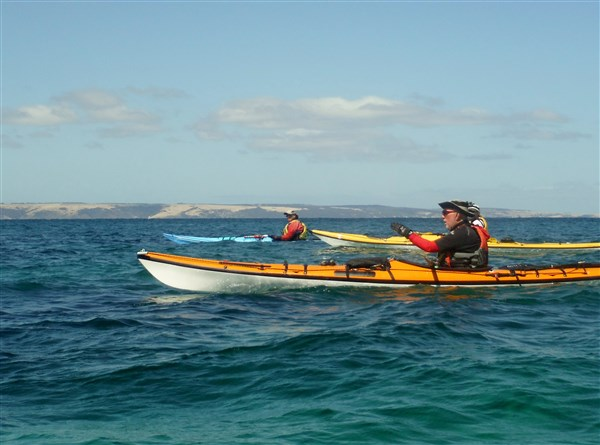 Paddling close inshore to avoid the winds.